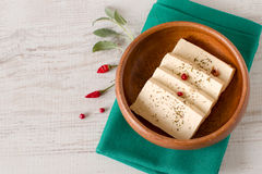 Slices of raw tofu. With herbs and spices on wooden bowl. Top view Stock Photos