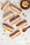 Slices of raw vegan cashew cake on white background, top view. Vegan food, food flat lay stock photo