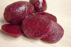 Slices of red beet on the wood Stock Image