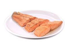 Slices of red fish fillet on plate. Stock Photos