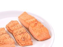 Slices of red fish fillet on plate. Royalty Free Stock Photos