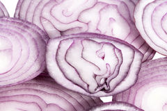 Slices of red onion on white background, close up Stock Image