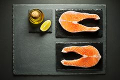Salmon steak ingredients for cooking healthy meal Stock Photos