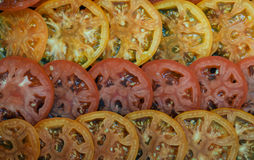 Slices of red and yellow tomatoes. Culinary background. Selective focus Stock Photography