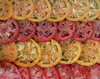 Slices of red and yellow tomatoes. Culinary background. Selective focus Royalty Free Stock Photos
