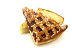 Slices of rice and cream and cherry pie Royalty Free Stock Photo