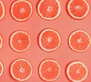 Slices of ripe juicy orange toned in trending coral color. Background with slices of ripe juicy orange toned in trending coral color royalty free stock photography