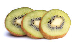 Slices of ripe kiwi with mint leaves on a white Stock Photo