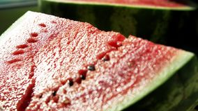 Slices of ripe red watermelon. Beautiful delicious, juicy sliced watermelon, on the table, colorful. Ripe fruit, natural product, fresh products, big berry stock video