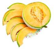 Slices of ripe sicilian cantaloupe melon on plate Royalty Free Stock Photo