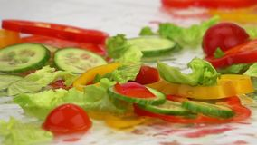 Slices of Ripe Vegetables are Falling on the Table. stock video