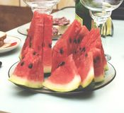 Slices of a ripe watermelon on a festive table, closeup, selective focus Royalty Free Stock Image