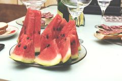 Slices of a ripe watermelon on a festive table, closeup, selective focus Stock Image