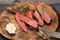 Slices of roast beef with garlic and rosemary Royalty Free Stock Images