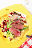 Roast beef with vegetable garnish Stock Image