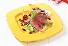 Roast beef with vegetable garnish Royalty Free Stock Photo