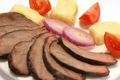 Slices roast beef and tomato Stock Images