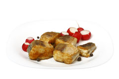 Slices of roast hake with radish Royalty Free Stock Image
