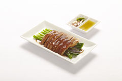 Slices of roast pork trotters with vegetable Royalty Free Stock Photo
