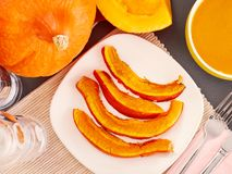 Slices of roast pumpkin on a plate, autumn food Royalty Free Stock Photos