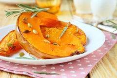 Slices of roast pumpkin on a plate Royalty Free Stock Image