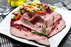 Slices roastbeef with mixed salad. Some slices roastbeef with mixed salad Royalty Free Stock Images