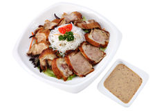 Slices roasted beijing duck  in a plate isolated on white. Stock Photos