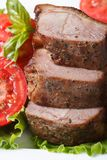 Slices of roasted duck meat fillets with tomatoes vertical Royalty Free Stock Image