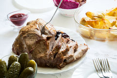 Slices roasted pork with plum sauce Royalty Free Stock Images