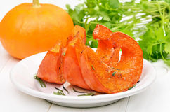Slices of roasted pumpkin on white plate, Royalty Free Stock Images