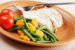 Slices of roasted turkey with vegetables Stock Photos