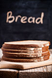 Slices of rye bread and blackboard Royalty Free Stock Image
