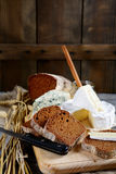 Slices of rye bread, camembert cheese and roquefort Royalty Free Stock Photography