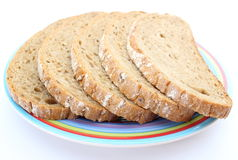 Slices of rye bread and colorful plate Royalty Free Stock Photography