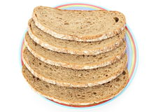 Slices of rye bread and colorful plate Royalty Free Stock Photos