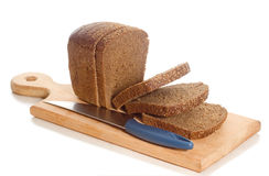 Slices rye bread knife board Royalty Free Stock Photo