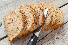 Slices of rye bread and knife Royalty Free Stock Photography