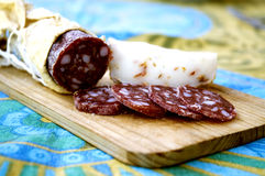 Slices of salami and cheese. Cutting board with slices of salami and cheese Stock Photo