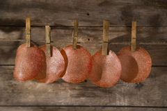 Slices of salami hanging. Presentation of slices of salami hanging by a thread stock images