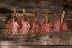 Slices of salami hanging Royalty Free Stock Photos