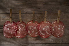 Slices of salami hanging Stock Photos