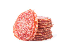 Slices salami isolated on a white Royalty Free Stock Image