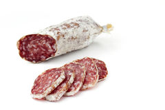 Slices of salami. Isolated on white background royalty free stock photography