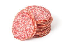 Slices salami isolated on a white Stock Photos