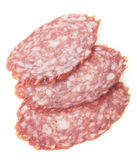 Slices of salami isolated on a white background Royalty Free Stock Images