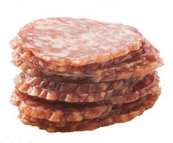 Slices of salami isolated on a white background Royalty Free Stock Photography