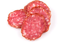 Slices of salami Stock Photos