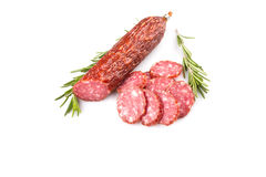 Slices of salami. Isolated on a white background Stock Photos