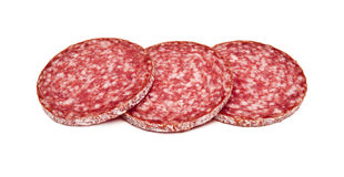 Slices of salami, isolated on a white background. Several slices of salami sausage. Sausage on a white background royalty free stock images