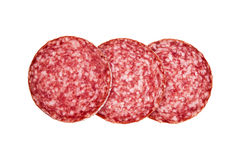 Slices of salami, isolated on a white background. Several slices of salami sausage. Sausage on a white background stock photography